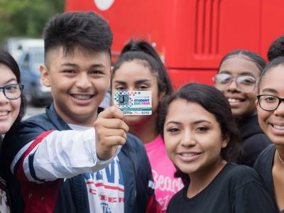 Group of students with bus pass